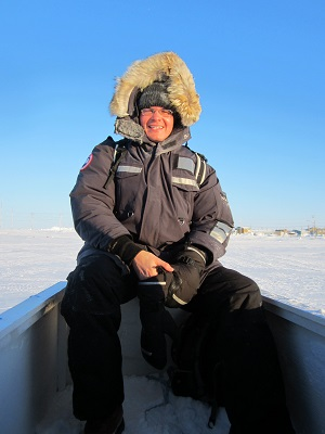Peter Kikkert in arctic wearing winter clothing.